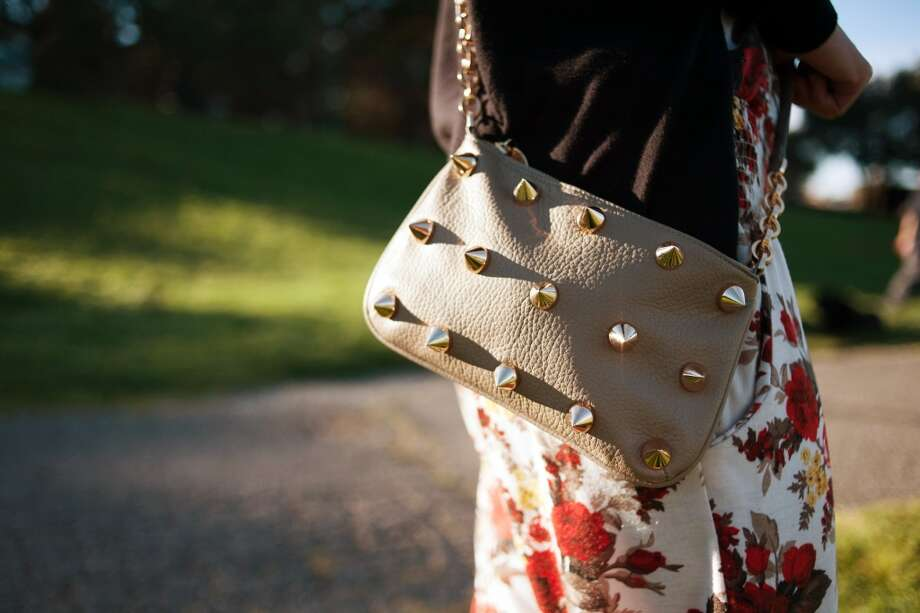 This studded cross-body bag was a gift from her fiance, found at Nordstrom. Photo: William C Rittenhouse