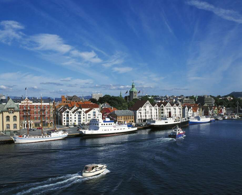 """9. Stavanger, Norway:This oil-rich port town, traditionally a gateway to the fjords, has become a destination in its own right, notes Lonely Planet's Managing Destination Editor Noirin Hegarty. """"It has developed a really interesting food scene, emphasizing local seafood and local produce, and is now regarded as being the center of the best cuisine in Norway,"""" she explains. """"There are lots of food festivals through the summer months, with  a quarter-million visitors to a food estival in July alone."""" Europe's largest wooden city is also """"really picturesque,"""" Stavanger adds, although admittedly quite pricey, like the rest of Norway. """"There are ways to get around paying high prices -- traveling in trains is not as expensive -- but this is a once-in-a-lifetime experience,"""" she notes. Photo: Brian Lawrence, Getty Images"""