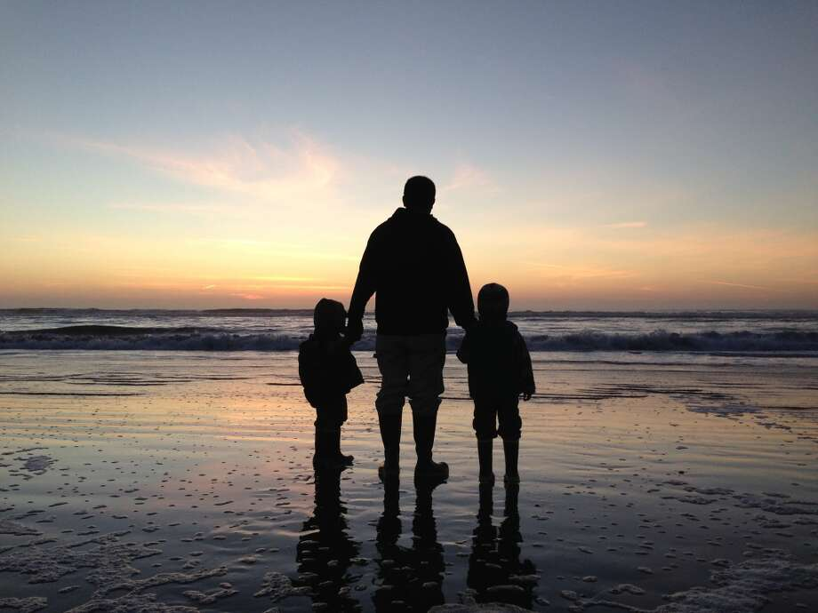 """Mike Mendoza and sons Xavier and Santiago Mendoza at Ocean Beach. Last sunset of 2013."""