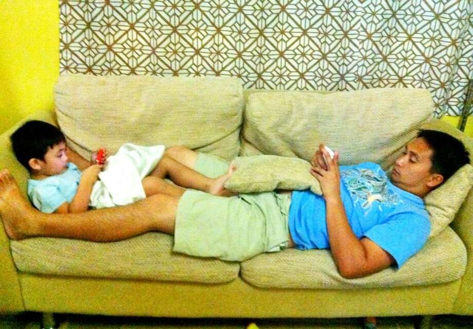 """""""Father and son modern day quality time."""" Photo: Submitted By Tanya Flores"""
