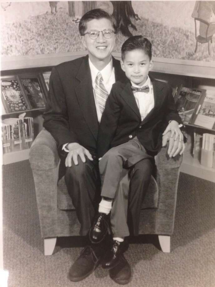 """'BO VA CON RAT YEU QUI' (Father And Most Precious Son). Anh Le (father) with Minh Jeffrey Lê (son)."""