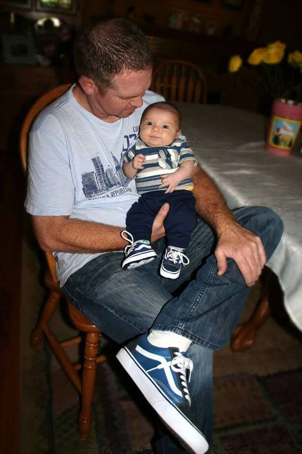 """John Goulart (father) and baby Charlie (10 weeks in this photo). This is their first Father's Day."""