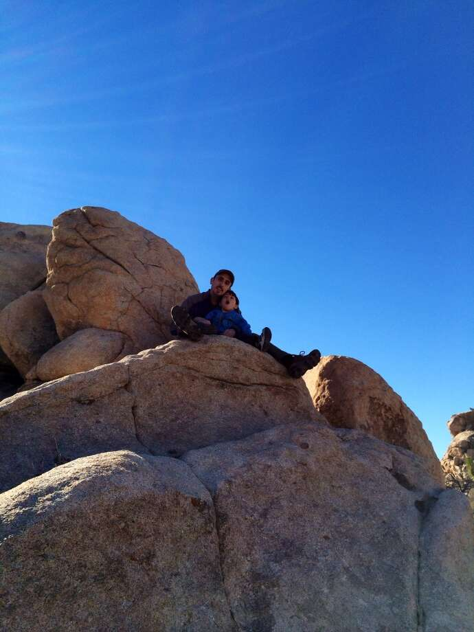 """Fathers and sons enjoy climbing rocks together, Joshua Tree NP, December '13."""