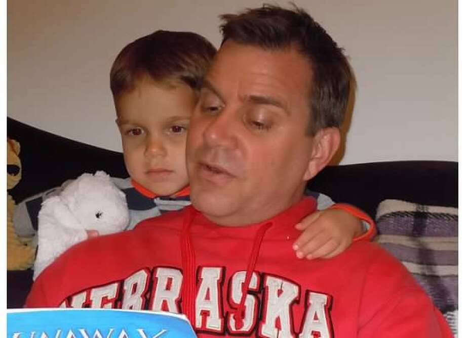 """Father and son bedtime stories.   Justin Sommer and son, Kylan Sommer."""
