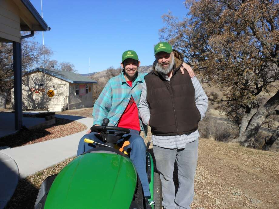 """This father and son like to ride tractors."" Photo: Submitted By Maureen Coryn"
