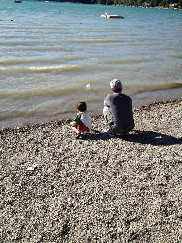 """Father and son skip stones together, Montana, August 2013."" Photo: Picasa"