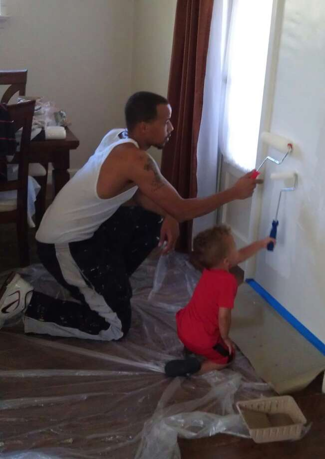 """Dyonte and Karter Lindsey of Fairfield knock out a painting project."""