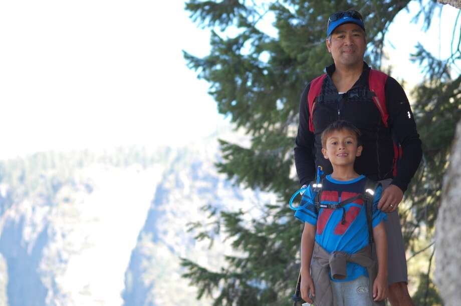 """My husband, Phillip Hereso, and my son, Felix Hereso, hiking to Glacier Point, Yosemite in Fall 2012 (Felix is 7)."""