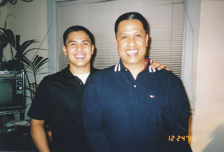 """This is my husband Lawrence with his Dad in 1998. I think they had the same hairdresser."" Photo: Submitted By Vilavanh Fulgencio"