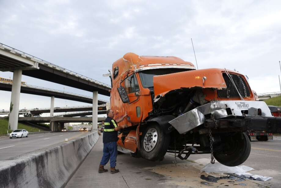 Portions of Texas 288 were still shut down during rush hour Friday morning after an 18-wheeler wreck on Friday night, according to Houston TranStar. The big rig reportedly lost a load of frozen chickens in the accident. Photo: Cody Duty, Houston Chronicle