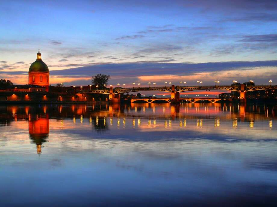 "10. Toulouse, France:Although it has a reputation as an industrial hub, this city in southwest France ""is really quite beautiful,""  says Lonely Planet's Managing Destination Editor Noirin Hegarty. ""It has an interesting, 2,000-year-old history and is  called 'the pink city' due to its sandstone,"" she notes.  ""It's really strong for rugby and sport -- the Heineken Cup was born in Toulouse. It has  two-star Michelin restaurants, lots of street cafes and Old World tea rooms, which are really affordable -- only 5 or 10 euros for afternoon tea. It's worth paying attention to."" Photo: Richard Fairless, Getty Images/Flickr RF"
