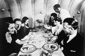 Passengers took cocktails at their seats before entering the dining lounge of the Martin M-130. Until 1944, only males were hired as attendants on overseas flights.