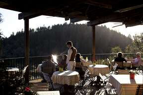 Guests dine on the outdoor patio overlooking the valley at  Auberge du Soleil  in Rutherford.