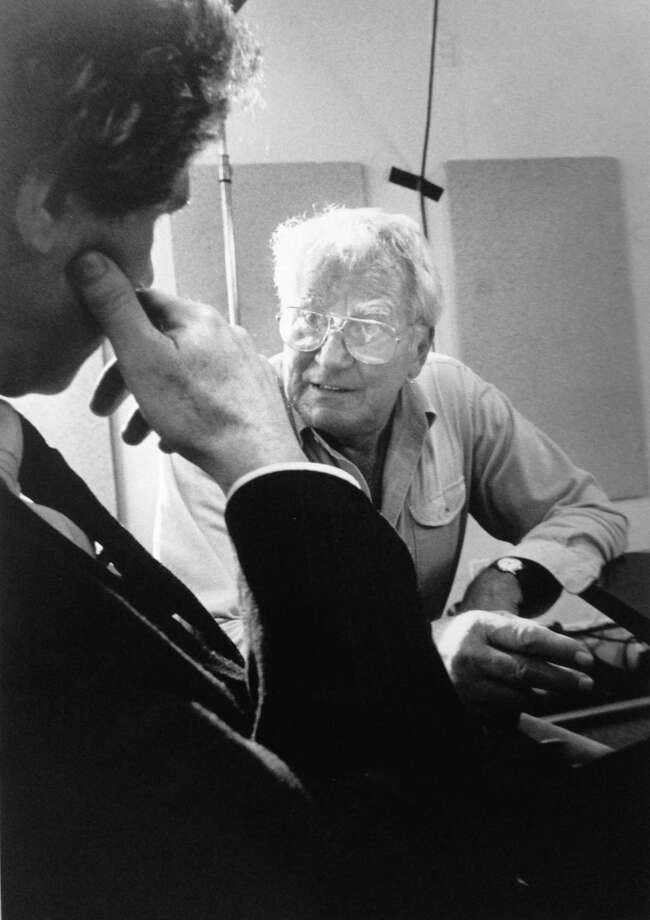 Late Stamford resident and film producer Sig Shore talks dialogue with an actor on location at the old municipal building on Federal Street on June 17, 1989. Photo: File Photo / Stamford Advocate File Photo
