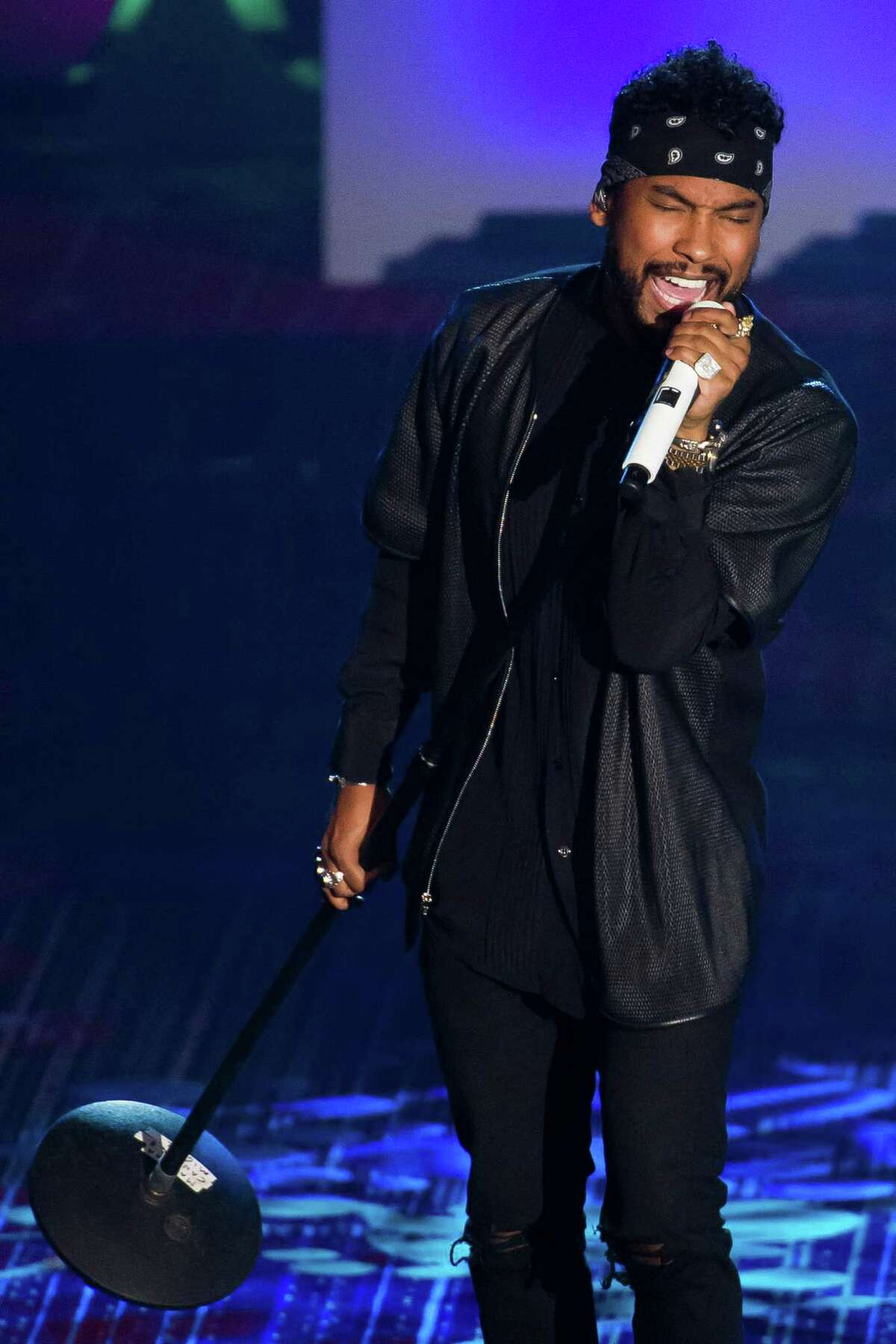 Miguel performs at the Songwriters Hall of Fame Awards on Thursday, June 12, 2014 in New York. (Photo by Charles Sykes/Invision/AP) ORG XMIT: NYCS114