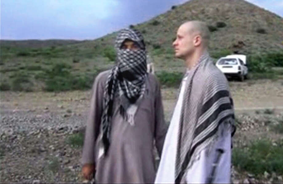 "FILE - In this file image taken from video obtained from Voice Of Jihad Website, which has been authenticated based on its contents and other AP reporting, Sgt. Bowe Bergdahl, right, stands with a Taliban fighter in eastern Afghanistan. Bergdahl was freed in a swap in which the U.S. freed five Taliban detainees, a diplomatic victory for the insurgent group. In a belt from Iraq to Pakistan, militants scored a series of successes the past weeks, a sign of their continued power 13 years into the U.S. ""war on terrorism."" Photo: Uncredited, AP / Voice Of Jihad Website"