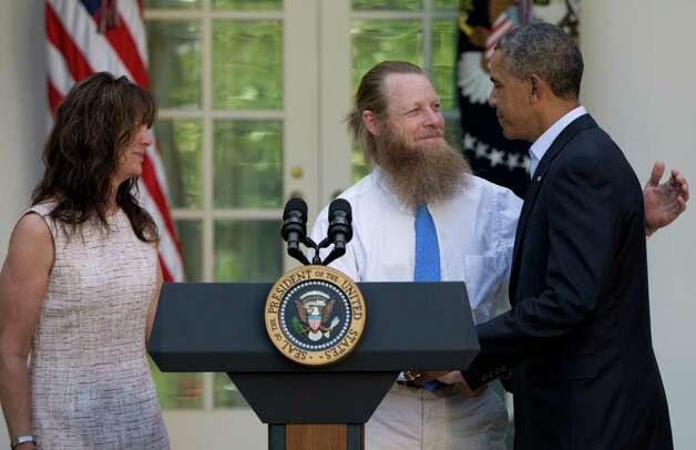 FILE - In this Saturday, May 31, 2014 file photo, President Barack Obama shakes hands with Bob Bergdahl as Jani Bergdahl stands at left, during a news conference in the Rose Garden of the White House in Washington about the release of their son, U.S. Army Sgt. Bowe Bergdahl. The soldier went missing from his outpost in Afghanistan in June 2009 and was released from Taliban captivity on May 31, 2014 in exchange for five enemy combatants held in the U.S. prison in Guantanamo Bay, Cuba. (AP Photo/Carolyn Kaster) ORG XMIT: NYPS413 Photo: Carolyn Kaster / AP