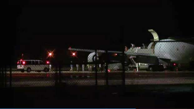 In this image from video, people are greeted on arrival at Lackland Air Force Base near San Antonio, early Friday morning June 13, 2014. Bowe Bergdahl, the Army sergeant who has been recovering in Germany after five years as a Taliban captive, returned to the United States on this plane to continue his medical treatment. Photo: Manis Calco, AP / ap