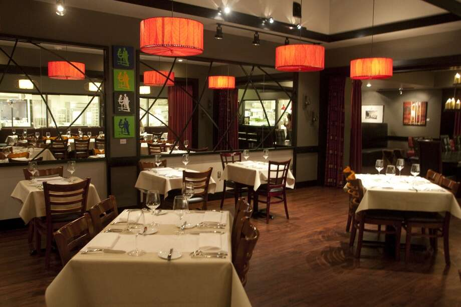 The dining room is set up for elegant dining at Kris Bistro. Photo: Patrick Schneider, For The Chronicle