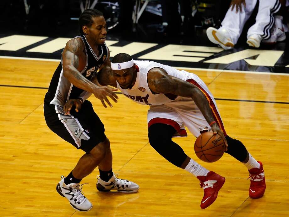 LeBron James controls the ball as Kawhi Leonard defends during Game 4 of the 2014 NBA Finals. Photo: Chris Trotman, Getty Images