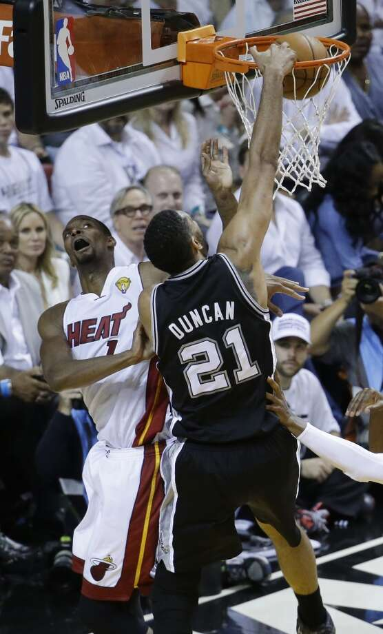 Tim Duncan dunks the ball over Chris Bosh during the second half in Game 4 of the NBA Finals. Photo: Wilfredo Lee, Associated Press
