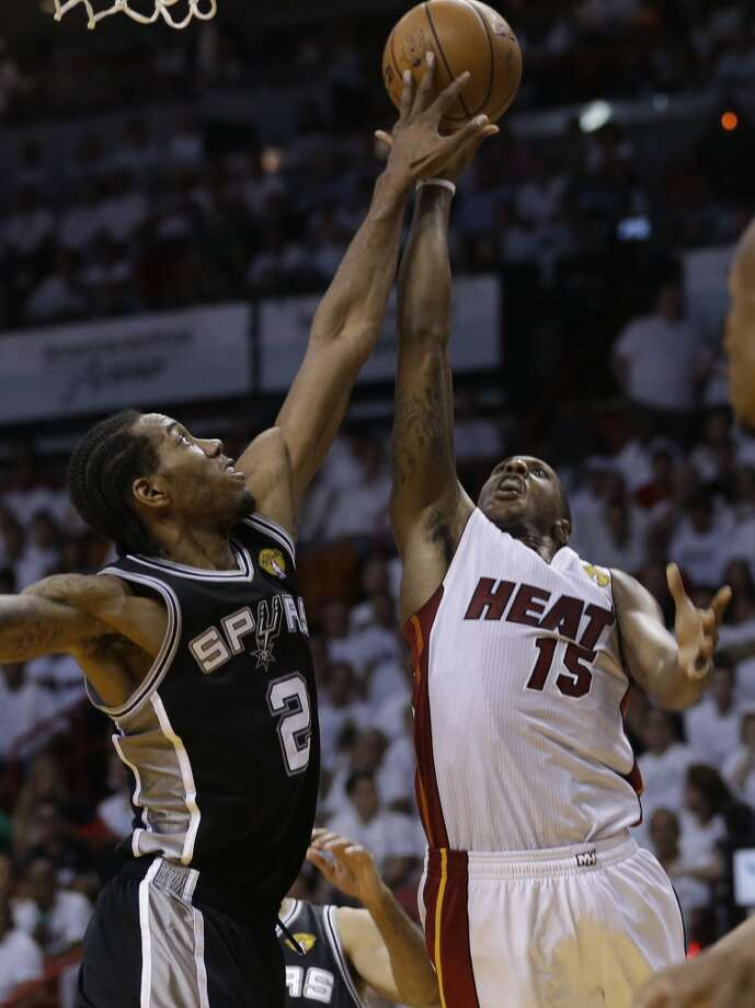 Mario Chalmers, right, drives to the basket as Kawhi Leonard defends during the second half in Game 4 of the NBA Finals. Photo: Lynne Sladky, Associated Press