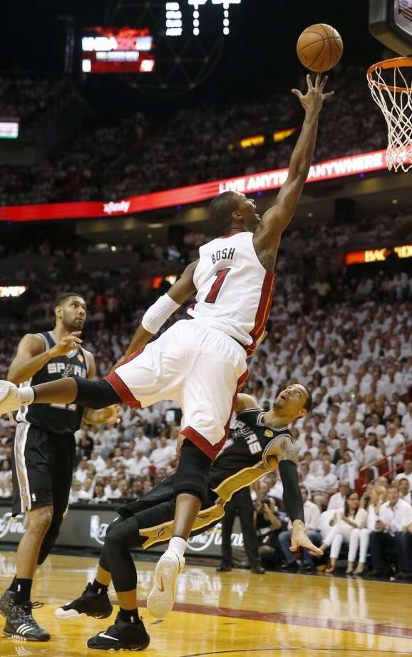 Chris Bosh, right, releases a shot over Danny Green in the first quarter during Game 4 of the NBA Finals. Photo: CHARLES TRAINOR JR, McClatchy-Tribune News Service