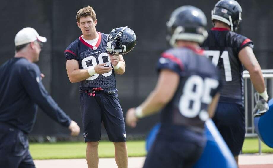 Tight end Garrett Graham takes a break between drills. Photo: Brett Coomer, Houston Chronicle