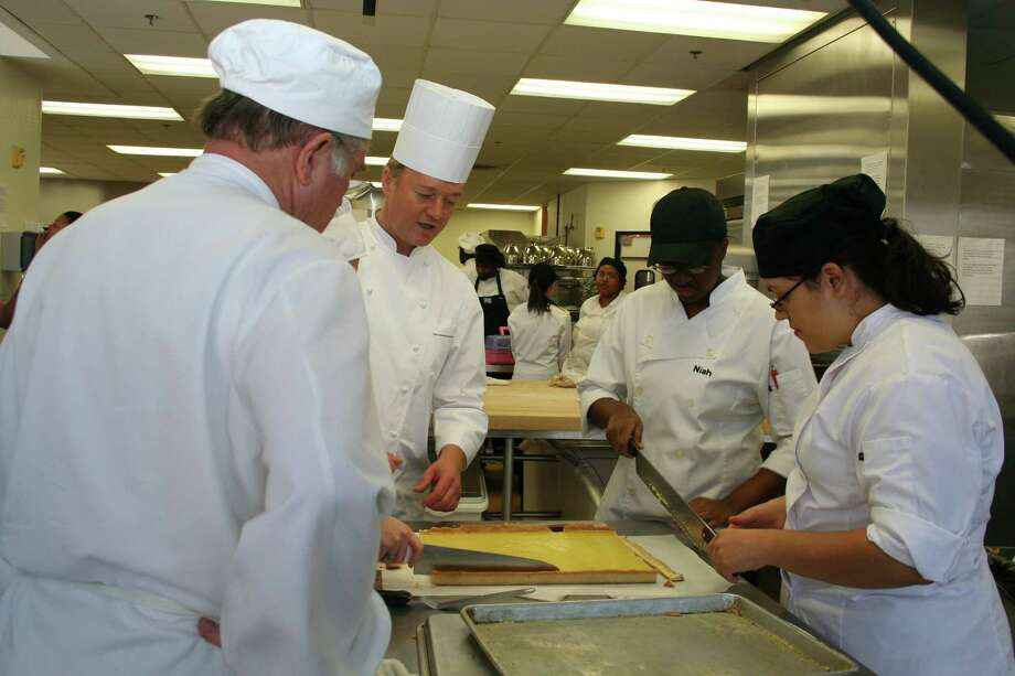HCC's culinary arts program offers a range of training. Chef Eddy Van Damme (second from left), bakery and pastry arts professor at HCC-Central, works with students.