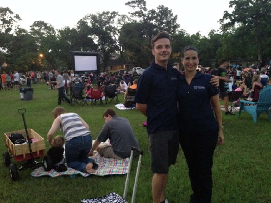 """Martha Turner broker associate Leann Salmons and her assistant Millard """"Spur"""" Wood pitched in to make Oak Forest's Movie Night a good time — and a great event for Rescued Pets Movement."""