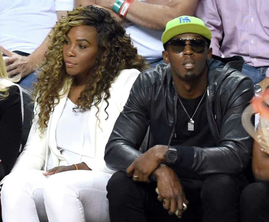Serena Williams and  Usain Bolt watch the Miami Heat and San Antonio Spurs during Game 4 of the 2014 NBA Finals on June 12, 2014  at the American Airlines Arena in Miami, Florida.  Photo: TIMOTHY A. CLARY, AFP/Getty Images / AFP