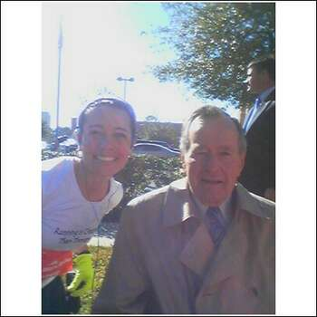 Participant Bernadette Tretta poses with former President George H.W. Bush during the 2008 Chevron Houston Marathon. Photo: Courtesy Bernadette Tretta / ONLINE_YES