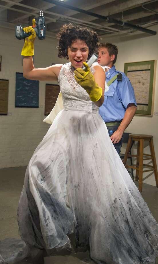 "Amy (Carla Pauli) defeats the sewer system  in Ignacio Zulueta's ""The Fellowship"" at AlterTheater Photo: David Allen"