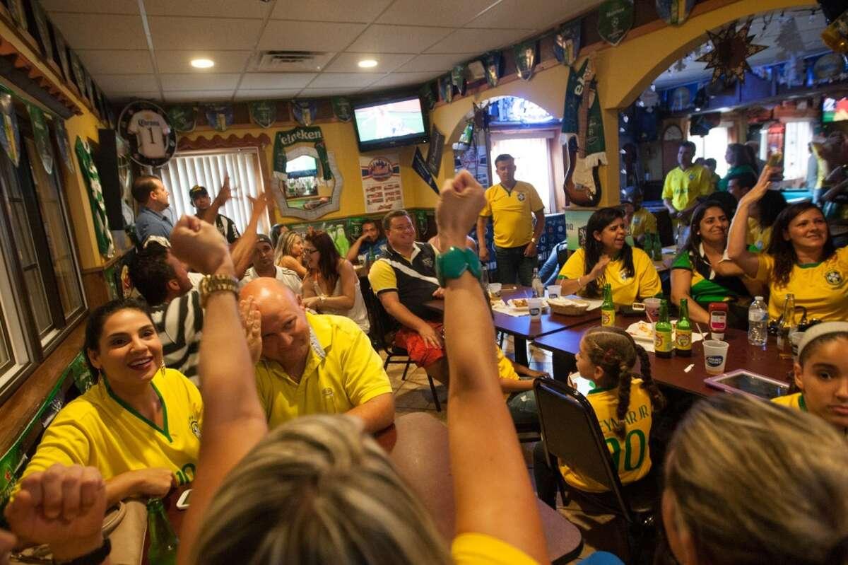 Brazil fans watch the Brazil vs. Croatia World Cup opening match at the Old Oak in Danbury, CT.