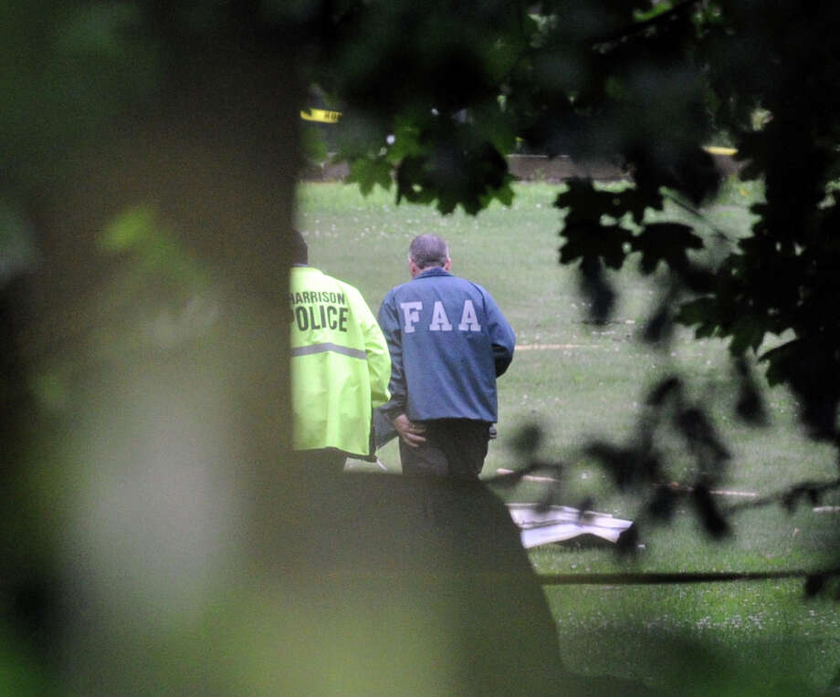 The scene of a plane crash at Cottage Avenue in Purchase, N.Y., Friday afternoon, June 13, 2014. A  Rockefeller family spokesman says the pilot of the small plane who died moments after taking off from a Westchester County airport Friday morning was Richard Rockfeller, great grandson of Standard Oil co-founder John D. Rockefeller. Photo: Bob Luckey / Greenwich Time