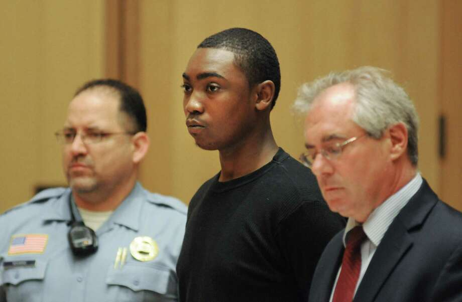 "Andre Quinn Russell, 20, of 83 Ludlow St.,is arraigned at the Stamford courthouse Friday June 13, 2014 charged with the Thursday night murder of William ""Buttons"" James. Russell is being held in lieu of a $1 million bond. Photo: Dru Nadler / Stamford Advocate Freelance"