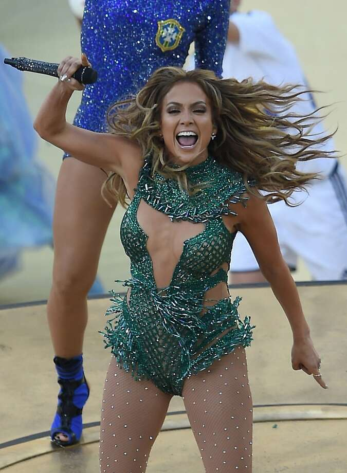 J.Lo sparkles:Although it was reported that Jennifer Lopez would not be joining Pitbull and Claudia Leitte for the World Cup opening ceremony in Sao Paolo, there she was, singing her heart out in an outfit that looks like it was borrowed from the Sambadrome   Carnival. Photo: Pedro Ugarte, AFP/Getty Images