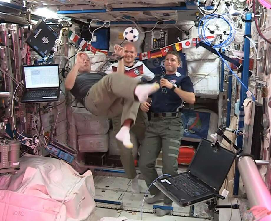 Unlike on Earth, the odds are in the Americans' favor: U.S. astronauts Steve Swanson (left) and Reid Wiseman (right) play two-against-one soccer with German astronaut Alexander Gerst in zero gravity aboard the International Space Station. Photo: Nasa, Associated Press