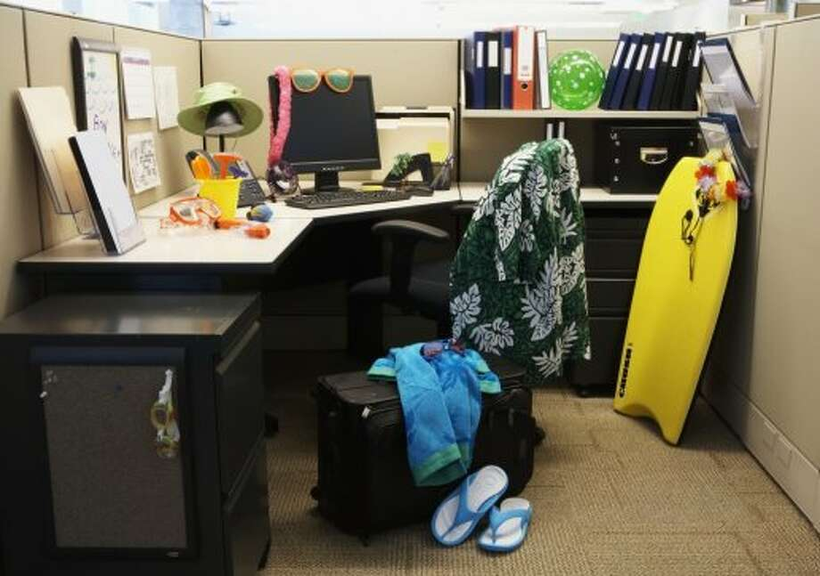 "Some office decor sends a specific message -- like ""I'm ready for vacation"" -- so make sure yours is sending the right signals. Photo: Thomas Northcut, Getty Images"