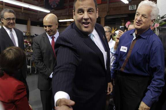 New Jersey Gov. Chris Christie greets supporters during a campaign stop for California Republican gubernatorial candidate Neel Kashkari (second from left) at Hoogasian Flowers in San Francisco, Calif. on Friday, June 13, 2014. Gov. Christie announced his support and endorsement of Kashkari's run for governor.