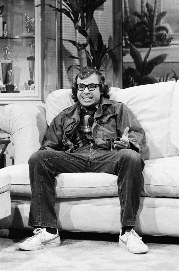 """Rick Moranis -- Louis Tully -- got his start on the Canadian """"Second City Television,"""" where he became known for his impressions of Woody Allen and George Carlin, among others. There, he developed the character Bob McKenzie, which later made a turn in the movie """"Strange Brew.""""""""Ghostbusters"""" was one of his first films. Aykroyd wrote the character with John Candy in mind, but Candy turned down the role. Photo: NBC, Getty / © NBCUniversal, Inc."""