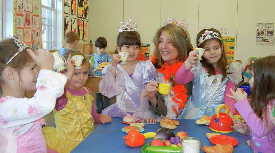 Cindi Bigelow, the CEO of Bigelow Tea, has tea with preschoolers at the Fairfield YMCA. Bigelow Tea is a supporter of the YMCA's annual campaign. Photo: Contributed Photo / Fairfield Citizen