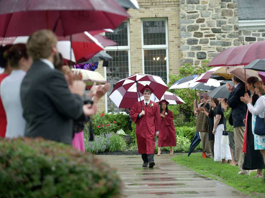 Benjamin David Bratter walks between two lines of faculty members during the Commencement procession for Wooster School, in Danbury, Conn, on Friday morning, June 13, 2014. Photo: H John Voorhees III / The News-Times Freelance