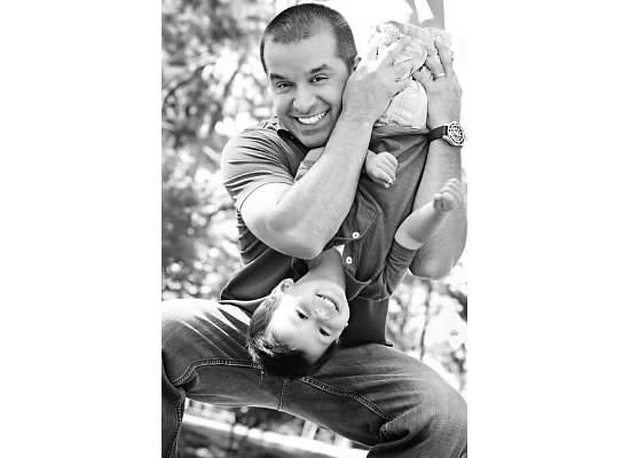 MarkosMarkos is such a great dad to John and our new baby Demitri. He carries John around every time he's using his backpack blower, because John loves it so much! He wakes up early to make him muffins or homemade biscuits every week. We are all so fortunate to have him! Photo: TK
