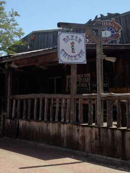 Lots of bars in Texas have the same essential DNA as the Dixie Chicken, but few of those bars can say that both John McCain and the president of Panama have eaten under the same roof where Robert Earl Keen and Lyle Lovett once swapped songs. (Photo: Dixie Chicken)