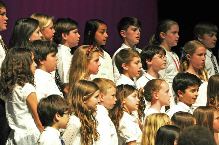 "The Tokeneke School Chorus performs a song from ""The Sound of Music"" during the recent spring concert. Photo: Contributed Photo, Contributed / Darien News"