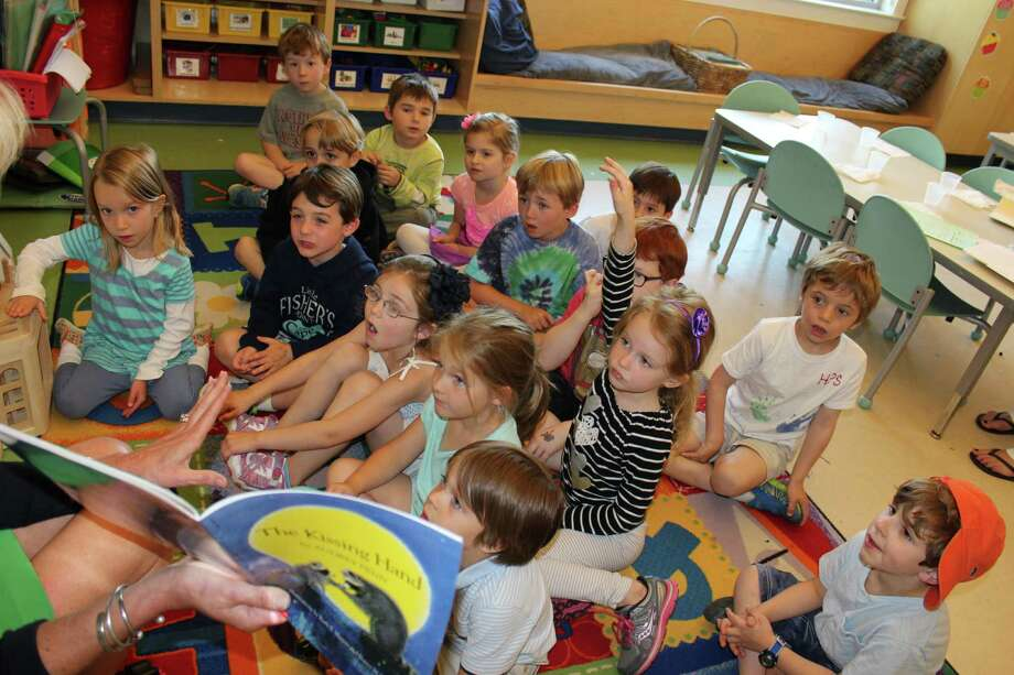 The Holly Pond Nursery School at the Darien YMCA recently hosted a read-a-thon that raised more than $5,000 for the 18,750 minutes that were read. The school's pre-kindergarten class read more than any other class at Holly Pond School. Photo: Contributed Photo, Contributed / Darien News