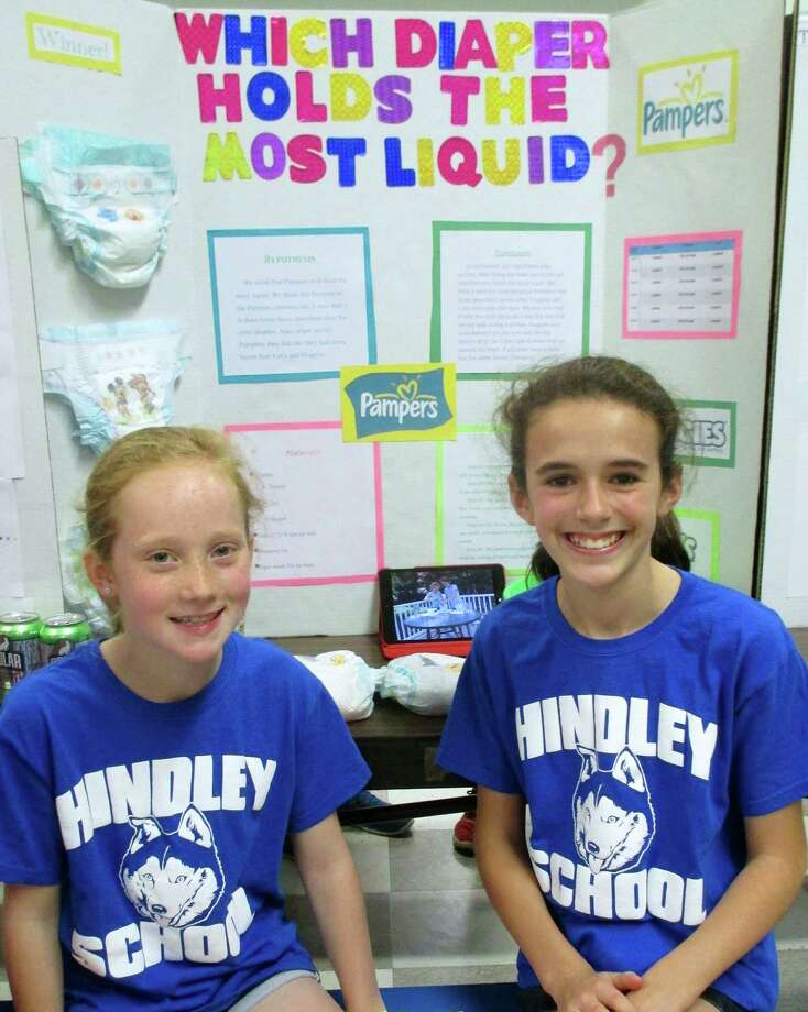 Hindley School fifth-graders Lizzie Canelli and Lucy Cullen compared diapers to conclude which brand could hold the most liquid during the Blue Ribbon Science Fair. (The winner was Pampers.) Photo: Contributed Photo, Contributed / Darien News