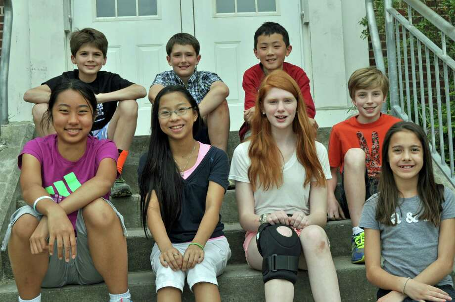 The Darien students who had perfect scores in the WordMasters Challenge included, from left in front row, Julia Tong, Charlotte Juan, Caroline Orphanos, Nicholas Derby and Emily Wiley; back row, Oliver St. John, Jack Towers and Ming Wu. Photo: Contributed Photo, Contributed / Darien News