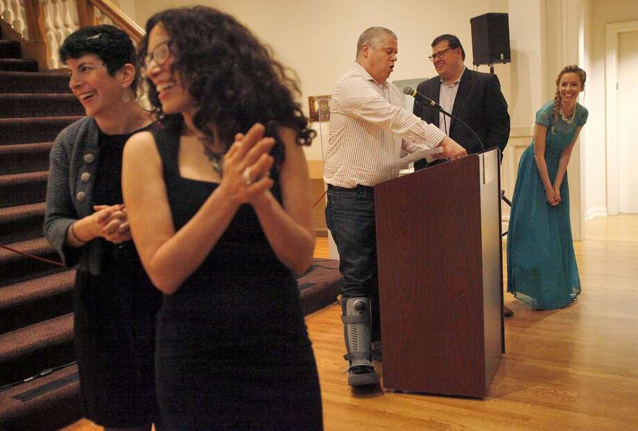 Daniel Handler (center) hosts a game show at Zyzzyva's 100th-issue celebration at the California Historical Society in S.F. To his right are Zyzzyva's managing editor, Oscar Villalon, and editor, Laura Cogan. Photo: Leah Millis, San Francisco Chronicle